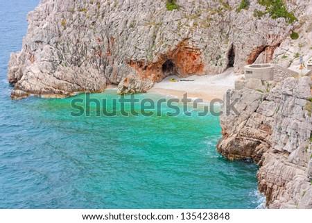 Blue lagoon in Adriatic Sea of Croatia. Island coastline. - stock photo