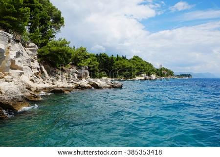 Blue lagoon, island paradise, mountain rocks. Adriatic Sea of Croatia, popular touristic destination. Europe, Croatia, Mediterranean sea background beach. - stock photo