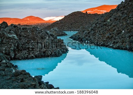 Blue lagoon - Volcanic formations filled with white-blue warm water - stock photo