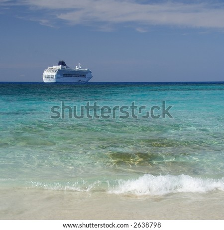 Blue lagoon with a cruiseship in the background - stock photo