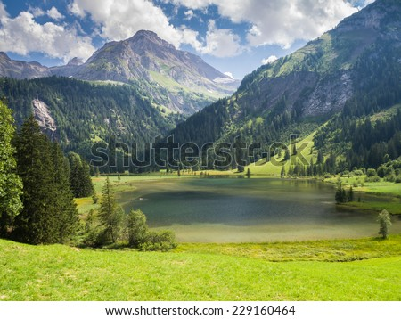 Blue lake in the mountains - stock photo
