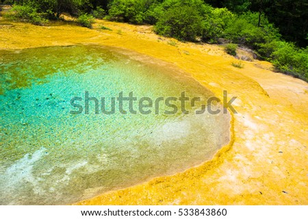 Blue Lake with yellow calcium. Huanglong, National park of China, Sichuan.