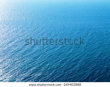 Blue landscape background sea surface backlit morning light of the setting sun in a wide range of brightness. For creative design - stock photo