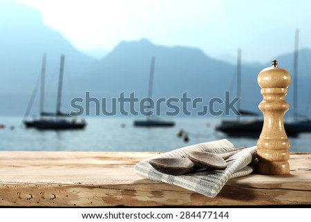 blue landscape of sea and boats and spoons and wooden space  - stock photo