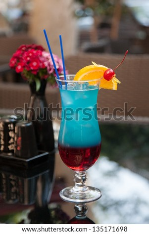 "Blue layered cocktail based on liquor ""Blue Curacao"""