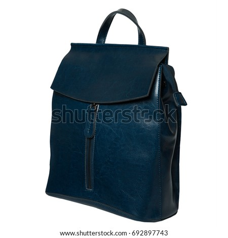Blue leather backpack standing isolated on white background
