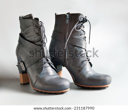 Blue leather boots on white background
