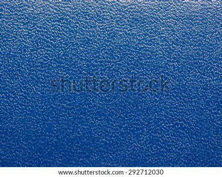 Blue leatherette texture useful as a background - stock photo