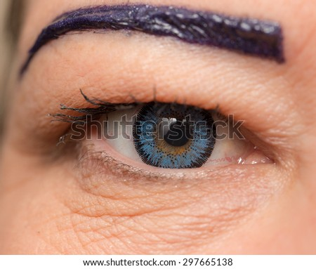 blue lenses in the eyes. close - stock photo