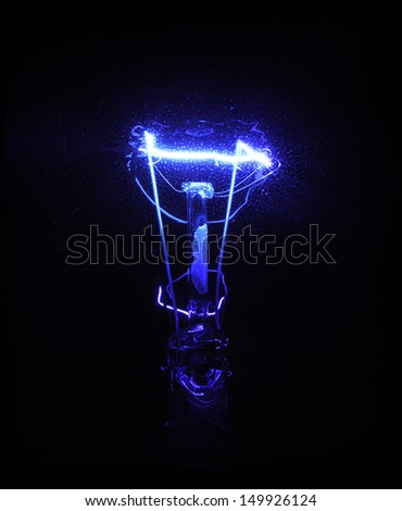 blue light bulb filament - stock photo