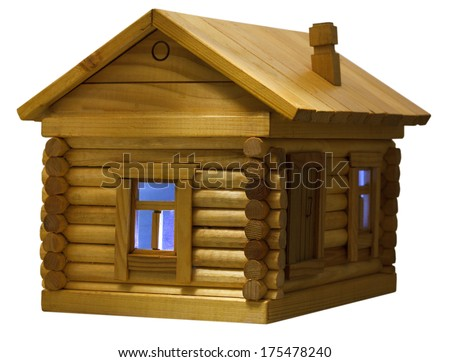 blue light in window of model of village wooden log house in evening isolated on white background