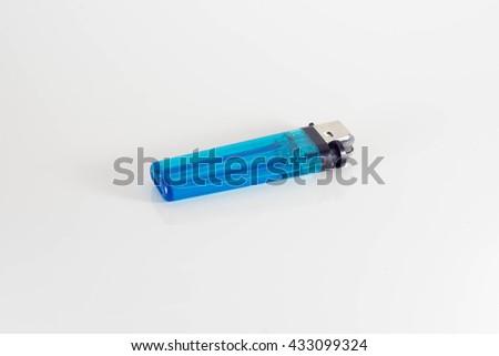 blue lighter on white background  - stock photo