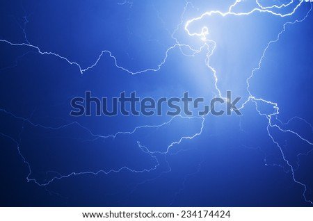 Blue lightning strike at night - stock photo