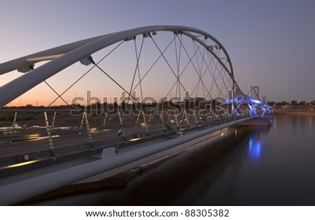 Blue lights of the Tempe Town Lake Pedestrian Bridge at Sunset - stock photo