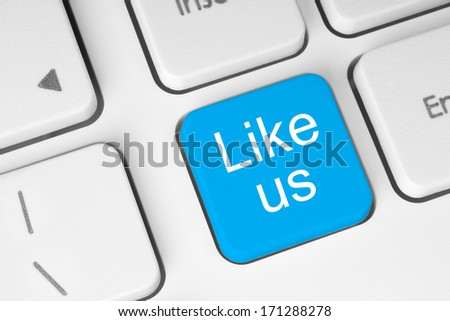 Blue like us button on keyboard close-up   - stock photo