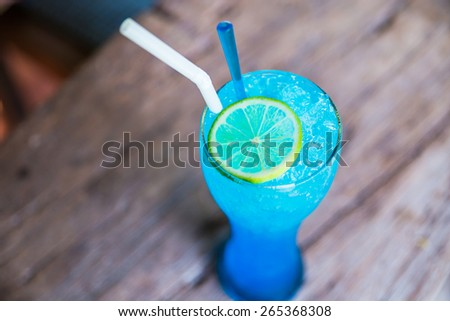 Blue Lime Soda on a wooden table. - stock photo