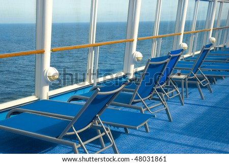 Blue Lounge chairs on deck of cruise ship