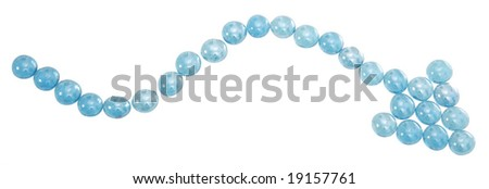 Blue marbles arranged in a squiggly arrow. - stock photo