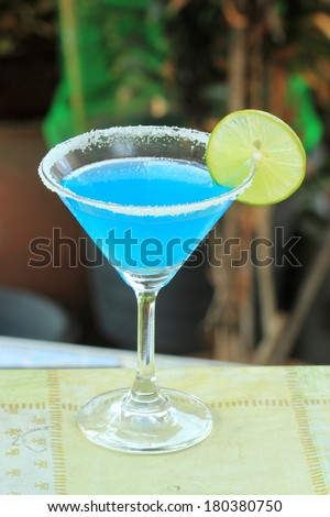 Blue margarita Cocktail in the garden background - stock photo