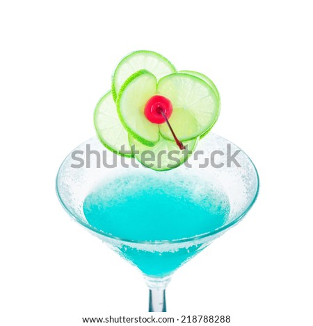Blue margarita cocktail with lime fruit and cherry decoration isolated on white background with copy space for party invitation text - stock photo