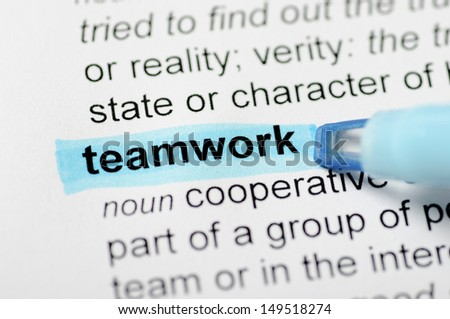 Blue marker on teamwork word