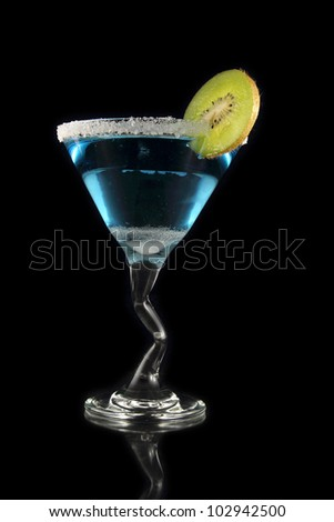 blue martini drink with kiwi on black background - stock photo