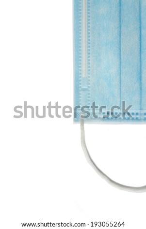 Blue medical mask on a white background - stock photo