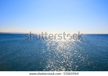 Blue Mediterranean sea at sunrise. - stock photo