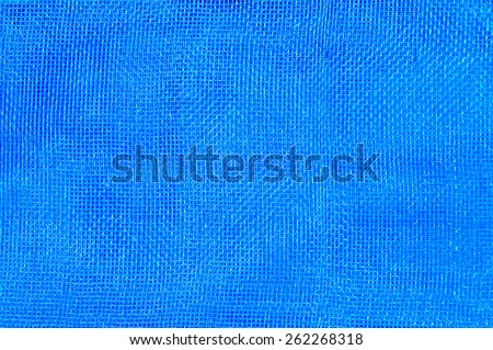 Blue mesh for texture and background. - stock photo