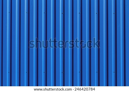 Blue metal siding wall texture background - stock photo