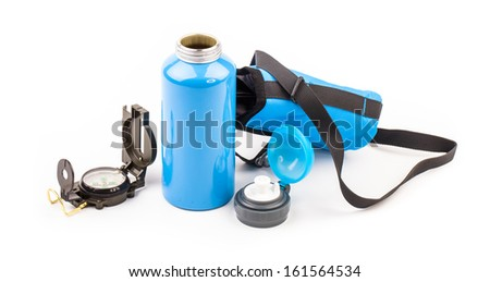 blue metal thermos and compass isolated on white background  - stock photo