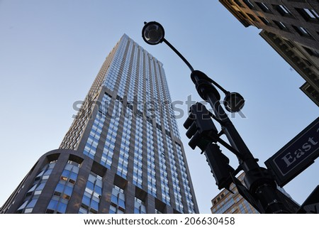 Blue mirror glass facade skyscraper buildings city : June 9, 2014 - stock photo