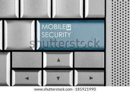 Blue MOBILE SECURITY key on a computer keyboard with clipping path around the MOBILE SECURITY key - stock photo