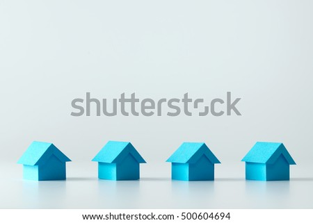 Blue model houses in a row for real estate concept