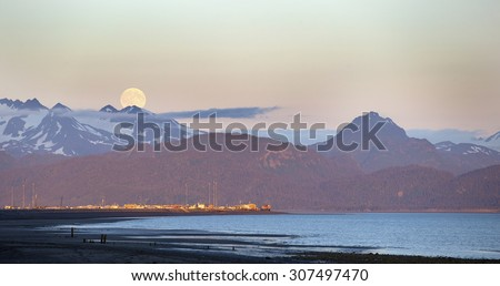 Blue Moon rising over Homer Spit, Alaska - stock photo