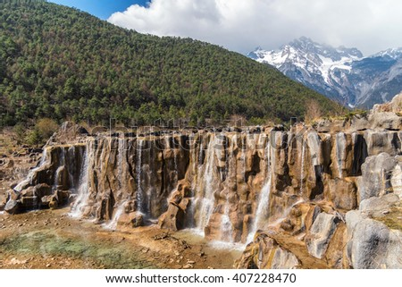 Blue moon Valley , White Water River waterfall and Jade Dragon Snow Mountain, Lijiang, Yunnan China. - stock photo