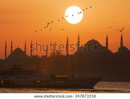 Blue Mosque and Hagia Sophia at sunset - stock photo