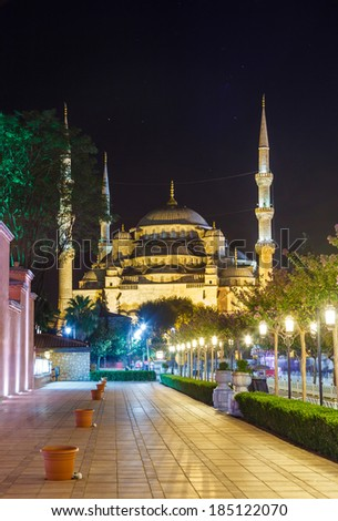 Blue Mosque in Istanbul, and the alley with lanterns in Sultanahmet Square at night