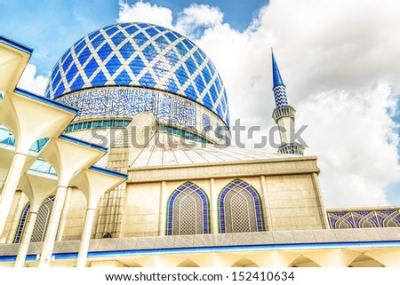 Blue Mosque in Shah Alam, Malaysia at summer. It si known as the Sultan Salahuddin Abdul Aziz Mosque. - stock photo