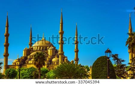 Blue mosque minaret in glorius sunset, Istanbul, Sultanahmet park. - stock photo