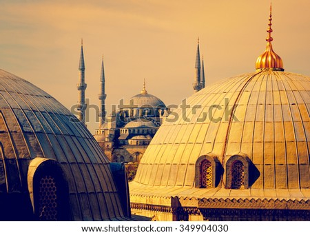 Blue Mosque with minarets, view from the Hagia Sophia dome. Famous turkish mosques of Istanbul at sunset, golden colors. Landmarks of islamic architecture in Turkey.