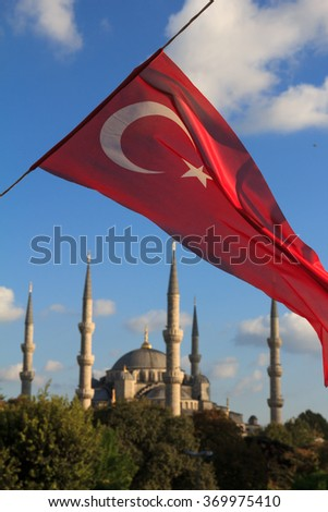 Blue Mosque with Turkish flags view from M. Arkif Ersoy Sultanahment Park Istanbul Turkey - stock photo