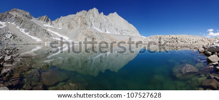blue mountain lake in the Williamson Basin reflecting Mount Tyndall and Versteeg - stock photo