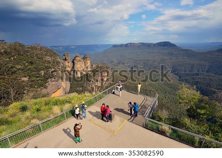 BLUE MOUNTAINS (NEW SOUTH WALES), AUSTRALIA - October 20, 2015 - Visitors taking photo and enjoying the mountain view at Echo Point,  The Three Sisters, Blue Mountain, Australia. - stock photo