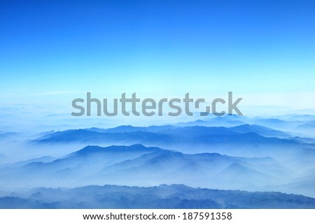 Blue mountains view from airplane flight  Hanoi to Bangkok. - stock photo