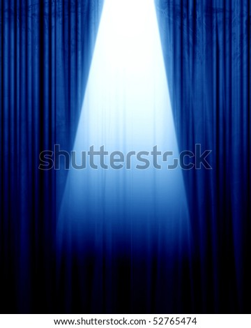 blue movie or theater curtain with a spotlight