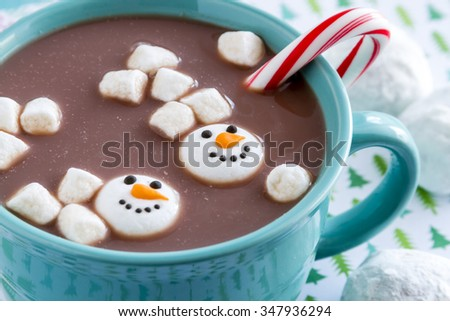mug filled with hot chocolate with snowman marshmallows, peppermint ...