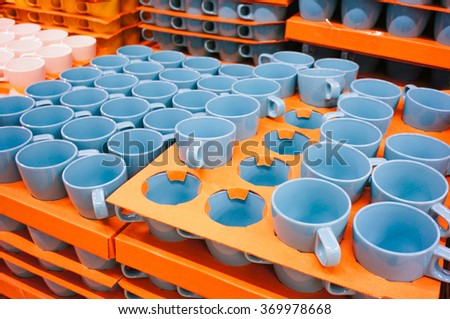 Blue mugs for sale in a store - stock photo