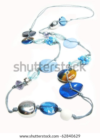 blue multicolored beads isolated on white background - stock photo