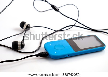 Blue music player with headphones on white background - stock photo